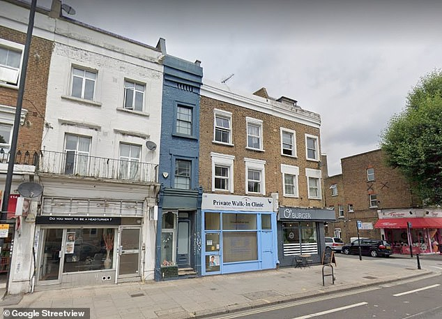The facade, situated between a nail salon and a pizza restaurant, is painted blue and the unusual property offers 1,034 sq ft and two bedrooms