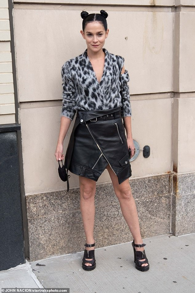 Funky: Model Leigh Lezark also showed up for the event, choosing an eclectic ensemble of cashmere top and black leather skirt with chunky peep toe sandal heels