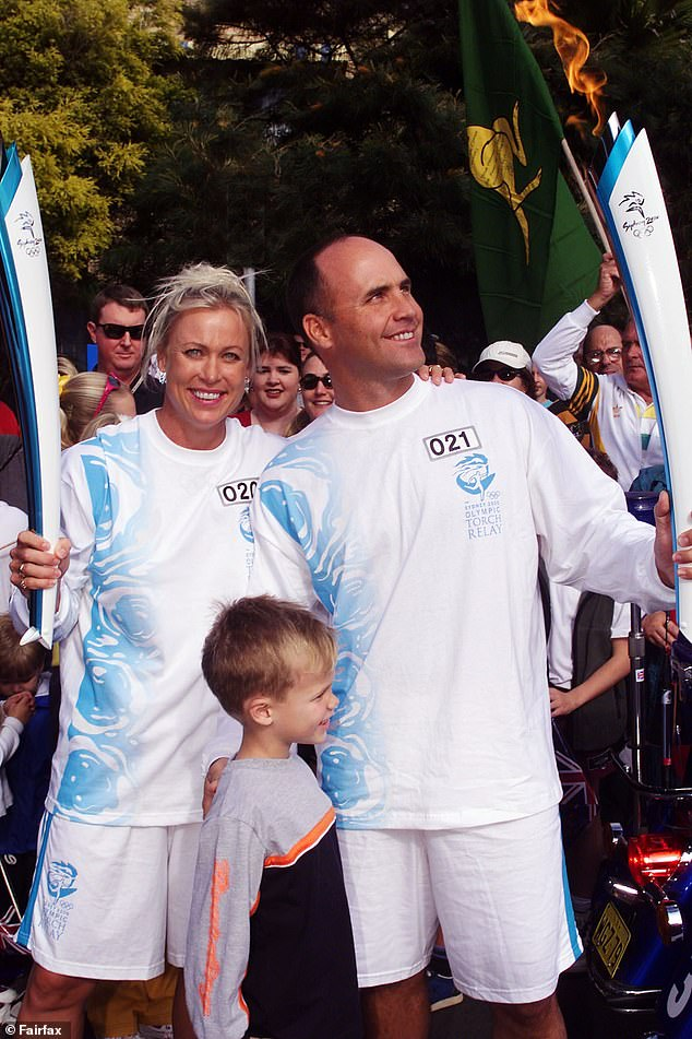80s sporting royalty: Australian swimmer Lisa Curry-Kenny and ironman and Olympic bronze medal winning athlete Grant Kenny with their son, Jett, during the Sydney 2000 torch relay