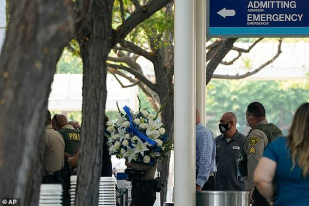 Police officers arrived at St. Francis Medical Center on Monday with flowers
