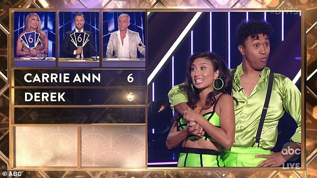 Confusing: At one point, Derek, Carrie Ann, and Bruno gave Extra TV host Jeannie Mai and her pro partner Brandon Armstrong high praise for their energetic salsa, while only delivering a collective score of 18 out of 30