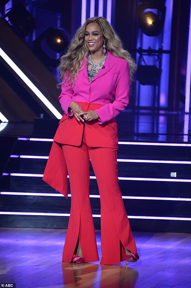 Outfit change: After Backstreet Boys' AJ McLean 'shot right out of the cannon' with his dance partner Cheryl Burke with the jive, Banks returned to the floor in an eye-popping fuchsia pantsuit with flared legs