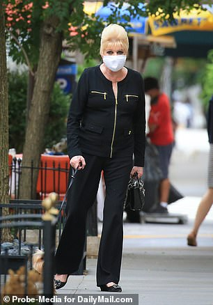 The businesswoman wore a fabric face mask before and after her meal to stay safe amid the coronavirus pandemic