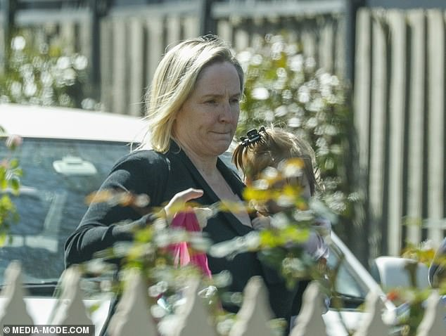 Heartbroken: A devastated Fifi Box emerged from her father's Melbourne home on Tuesday morning, just hours after learning of the death of Jaimi Kenny - the eldest daughter of her ex-partner Grant Kenny. Pictured with herone-year-old daughter, Daisy Belle