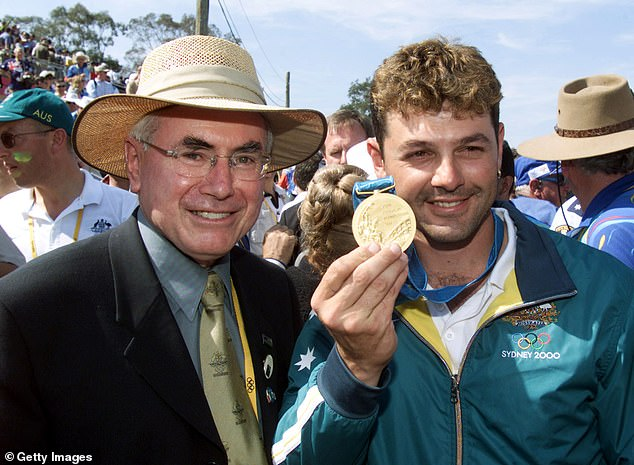 Diamond had won gold at the 1996 Atlanta Olympics in the men's trap and backed it up with another win in Sydney. He is pictured with then prime minister John Howard on September 17, 2000