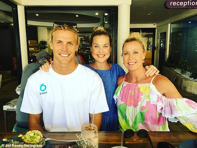 Grieving: Jaimi (centre) is survived by her Ironman father, former pro swimmer mother (right), brother Jett (left) and sister Morgan