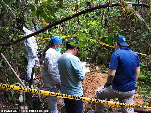 Pictures of the site released by the prosecutor's office showed officials in white coveralls digging in the dirt under thick vegetation