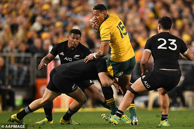 The Wallabies and All Blacks will meet in two Bledisloe Cup Sunday showdowns in New Zealand. Israel Folau is pictured being tackled during a Bledisloe Cup match in 2018