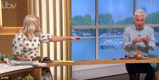 Not ideal:During the ITV chat show, chef James Martin hosted a masterclass where he 'lobbed' a freshly-cooked Yorkshire puddings at Phil whose finger accidentally got stuck in it