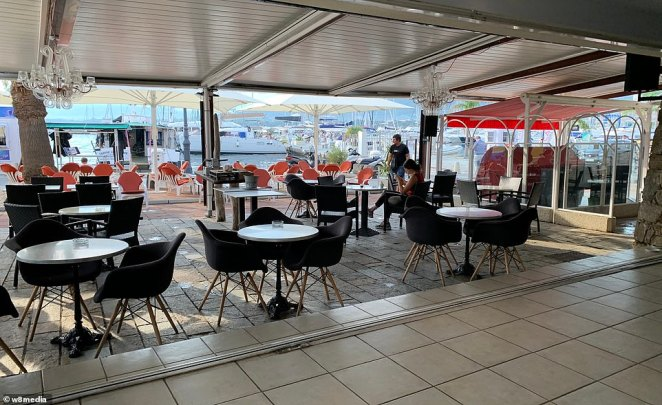 The bar opens up onto a terrace next to the sea front overlooking the mega yachts usually moored in the port