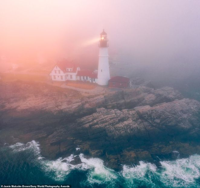 American photographer Jamie Malcolm-Brown is behind this shot ofPortland Head Lighthouse in Maine and said: 'The thick fog had a burst of colour come through as the last bit of sun set in the west. It only lasted a few moments but created a unique view of the often-photographed lighthouse.' It is an entry in the landscape category