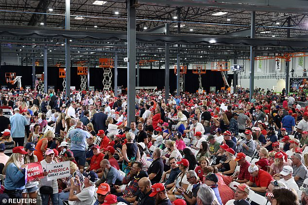 Relatively few people wore masks as they packed into thewarehouse facility in Nevada to hear Trump speak