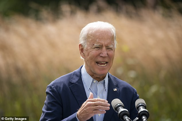 Democratic presidential nominee Joe Biden speaks about climate change and the wildfires on the West Coast at the Delaware Museum of Natural History yesterday in Wilmington, Delaware