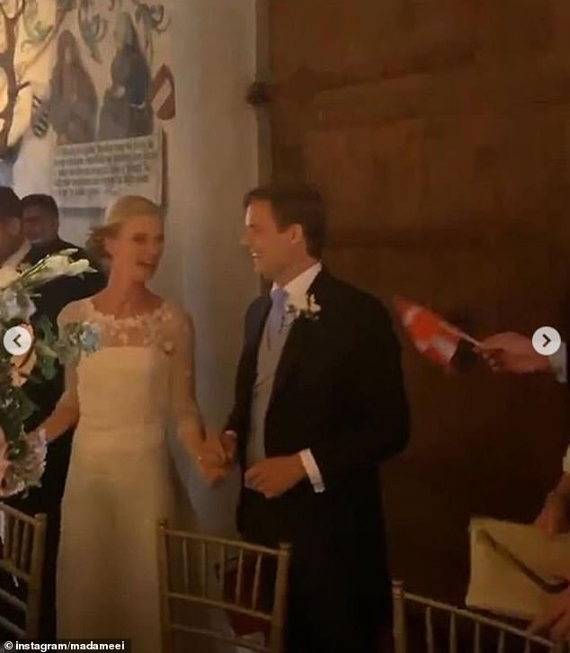 Snaps were shared as the couple celebrated their ceremony Inside the venue, which had been decorated with light blue and white flowers,