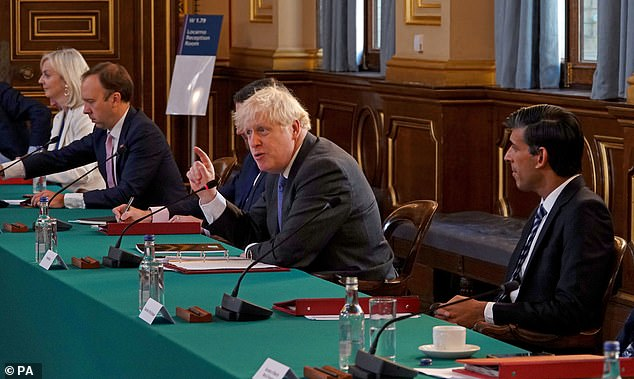 Mr Sunak with Boris Johnson at the weekly Cabinet meeting this morning