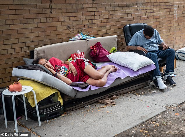 Homeless encampments have been seen cropping up across the city, often in affluent areas (Pictured:homeless encampment can be seen along West 38th Street between 9th and 10th Avenue in Manhattan)