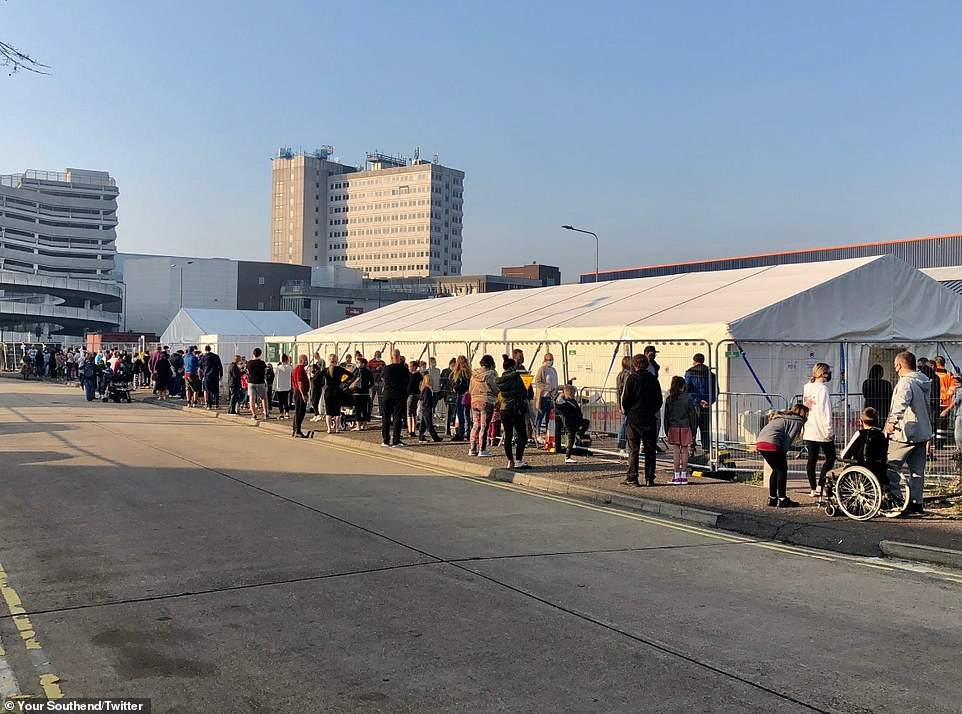 A huge queue of people is pictured outside a coronavirus testing centre at Southend-on-Sea, Essex, at 8am this morning. Many of the people reportedly turned up hoping they would be allowed in, but hadn't made appointments