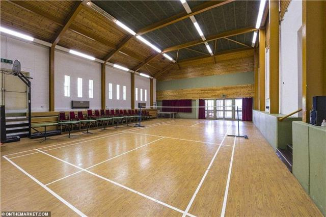 The leisure complex boasts a huge sports hall which is currently set up to be a badminton court (pictured)