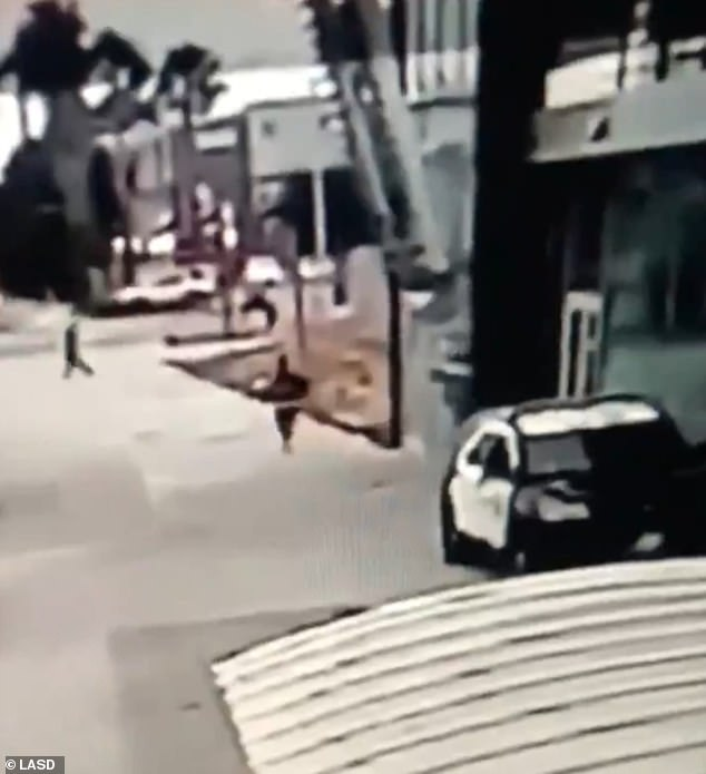 The gunman, said to be between 28-30, is pictured running from the scene on foot