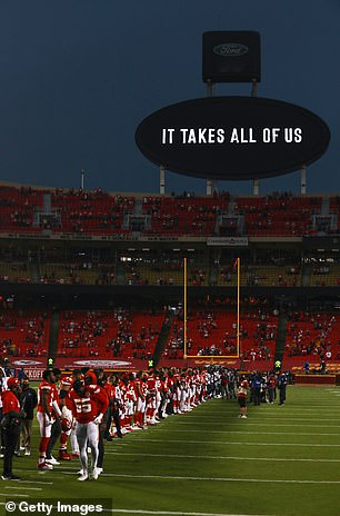Players from the Kansas City Chiefs and Houston Texans unite in a moment of silence before the start of a game at Arrowhead Stadium on September 10