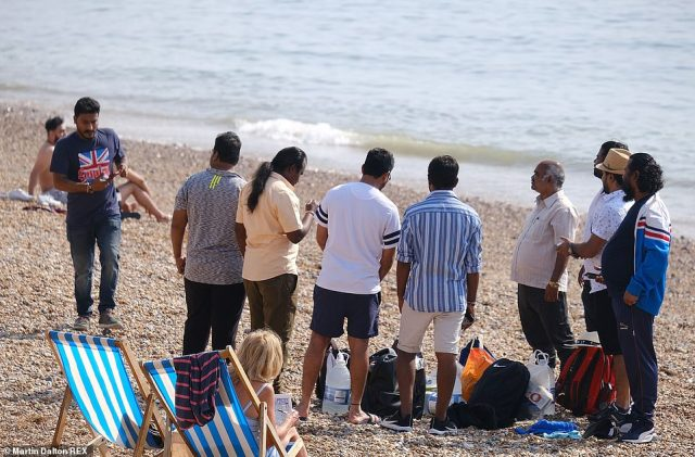 Large groups pictured on the Brighton coastline despite the government introducing the new 'rule of six' on Monday to deter mass groupings