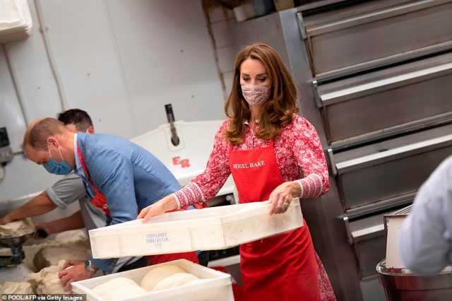 The couple appeared relaxed as they donned red aprons while working in the kitchen at the bakery and could be seen kneading dough on their visit