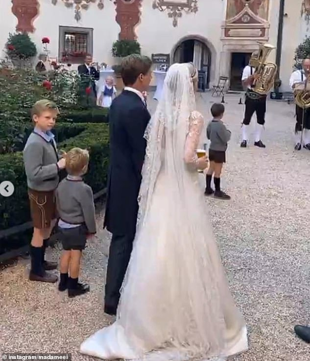 The young Archduchess of Austria wore a stunning white gown for the occasion with a sweeping lace veil