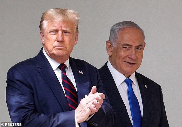 Pelosi said that Trump (left) gave her the 'crazy Nancy' nickname because he's the 'master of projection.' 'He calls other people crazy because he knows he is,' she said. Trump is photographed Tuesday with Israel's Prime Minister Benjamin Netanyahu (right)