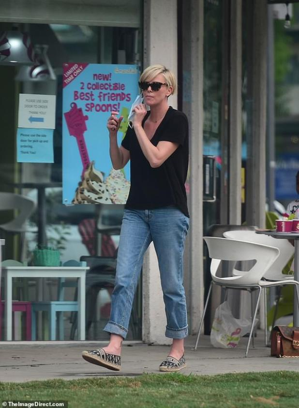 Out and about: Charlize steps into Sunday wearing jeans and a t-shirt