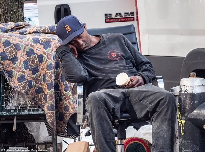 A homeless man sleeps on a chair at the corner of W80th Street and Broadway in the Upper West Side earlier this month
