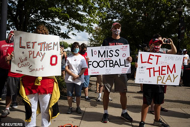 Fans attend a protest, staged by parents of Ohio State football players, against the cancelation of the Big Ten Conference's football season due to coronavirus disease (COVID-19) concerns outside Ohio State's stadium in Columbus