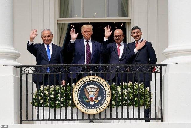 Israeli Prime Minister Benjamin Netanyahu, President Donald Trump, Bahrain Foreign Minister Khalid bin Ahmed Al Khalifa and United Arab Emirates Foreign Minister Abdullah bin Zayed al-Nahyan Abraham wave after the signing ceremony