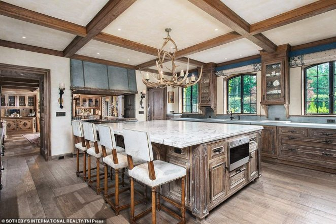 The sprawling French Normandy-style estate (kitchen pictured) was purchased by Hilfiger and his wife, 53-year-old former model Dee Ocleppo, bought the nearly 22-acre property in 2010 for $31.3million