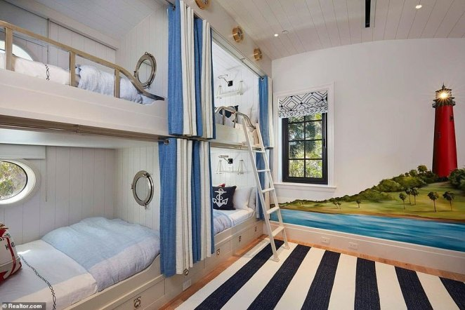 The home is perfect for entertaining visitors. Some of the 11 bedrooms contain multiple bunk beds, including the one above