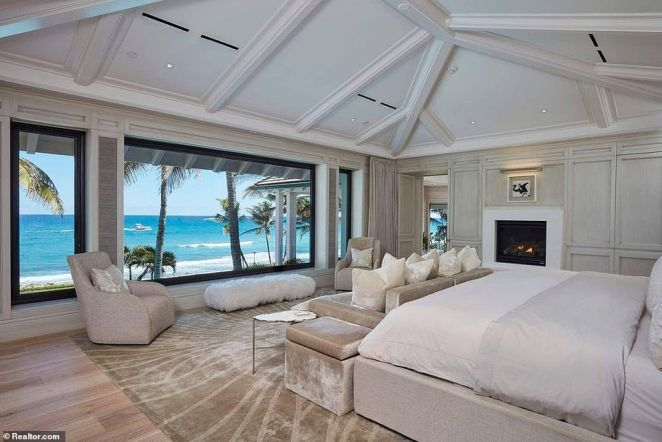 Inside the master bedroom, there are his and hers bathrooms, a walk-in closet, three fireplaces and a balcony perfect for watching the sunset over the Atlantic ocean