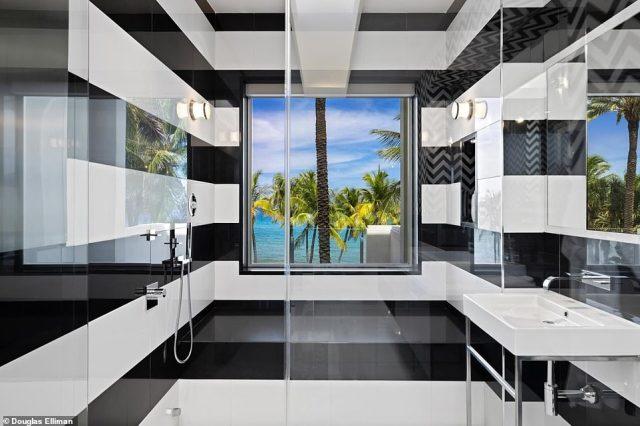 Florida estate: The master en suite bathroom features bold black and white stripes