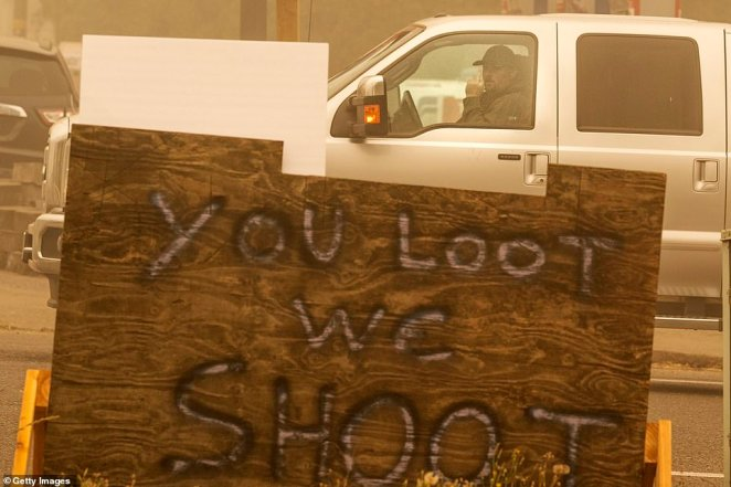 Clackamas County Sheriff Crag Roberts said Monday that his agency responded to more than 330 calls for service over the past week – a 400 percent increase from the previous week of people trying to protect their property or threatening others armed with guns. Some locals have erected signs like this one saying: 'You loot we shoot'