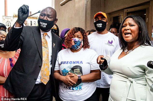 From left, Attorney Ben Crump, Breonna Taylor's mother Tamika Palmer and Until Freedom Co-Founder Mysonne Linen speak to press outside of City Hall following the civil hearing for Breonna Taylor's family