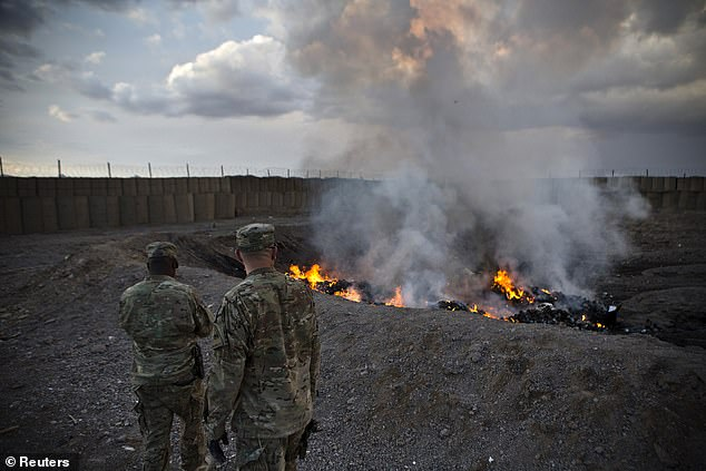 The phrase 'burn pit' refers to an area of a deployed military base devoted to open-air burning of waste often using jet fuel as an accelerant. Pictured,a burn-pit in Afghanistan in 2013