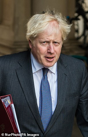 Boris Johnson returns to Downing Street after attending a cabinet meeting held at the Foreign Office today