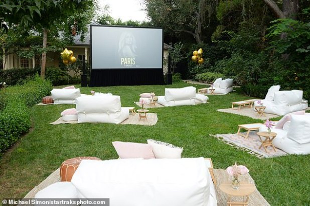 Distance: Although guests were not socially spaced while interacting, the grassy area had white sofas and mats placed for people's socially deformed pods.