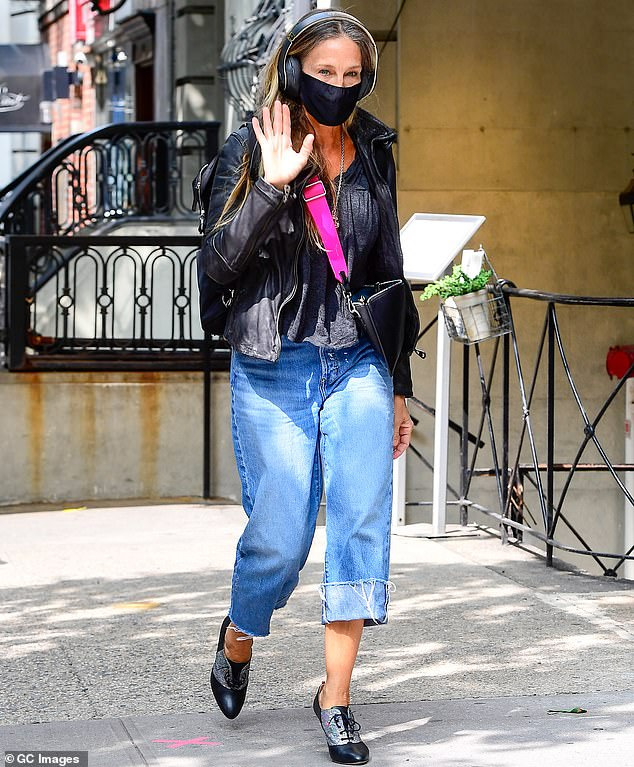 On the job: Sarah Jessica Parker, 55, was seen arriving at her NYC flagship store on Tuesday to help customers, including notable fashion designer Christian Siriano as she waived to the camera