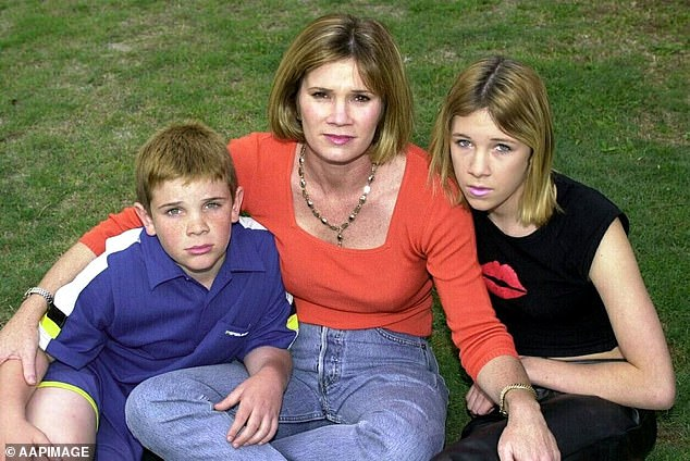 Wickham is pictured with her daughter Hannah (right) and son Daniel (left) in 2001 after a thief broke into their family home and stole three of her international gold medals