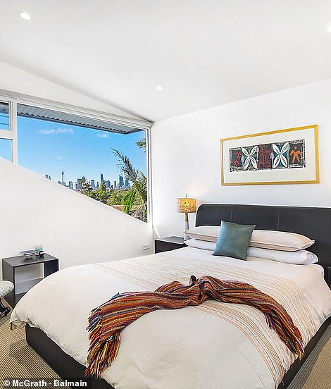 The window of the master bedroom provides an unrestricted view of the city skyline