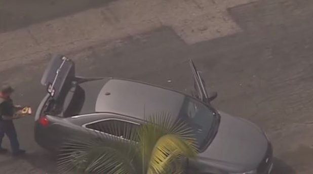 The LA County Sheriff's SWAT team is in a standoff with a suspect believed to be connected to the Compton gunman who shot two deputies in the head over the weekend, according to several law enforcement sources.  Featured carjacking scene