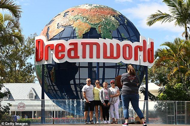 Dreamworld has reopened to visitors as its parent company prepares to return to court over safety offences. Pictured: Patrons pose for photos at Dreamworld entrance on September 16