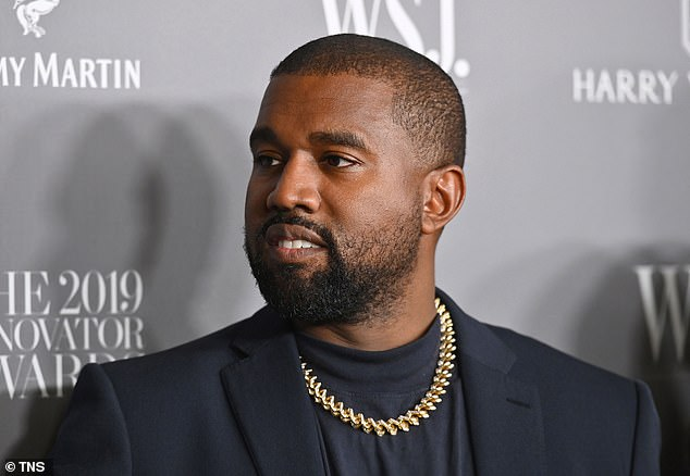 Kanye West revealed the giant wall he is constructing around his Los Angeles mansion as he continued his Twitter feud with music label Universal on Tuesday night