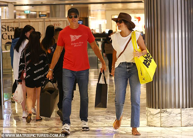 Style: Pia looked stylish in blue jeans, a white T-shirt and brown sandals for the shopping trip