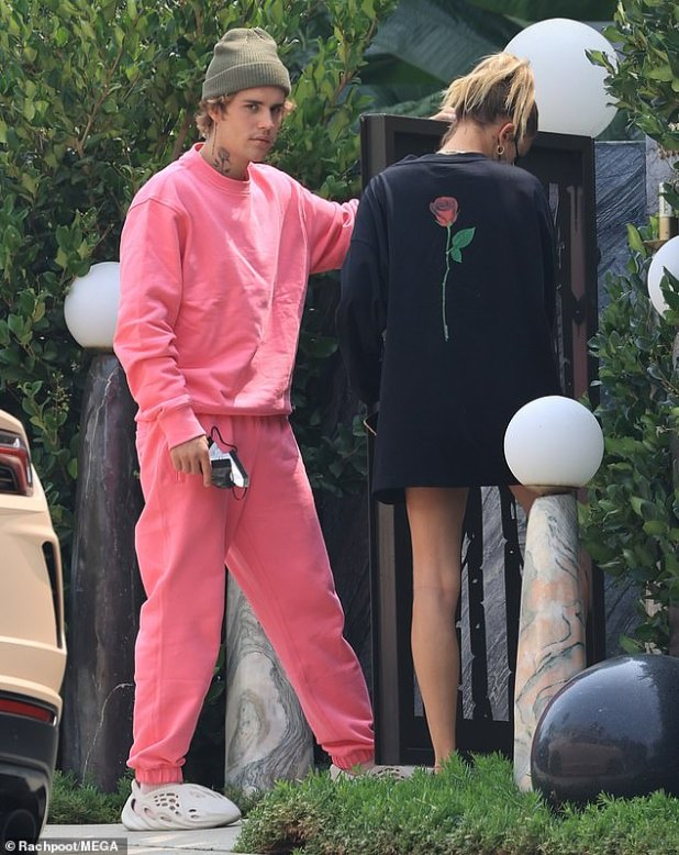 There he is: Dressed over a pair of matching sweat pants with a bright colored sweater, Justin was hard to remember while sleeping outside a friend's house with his model wife