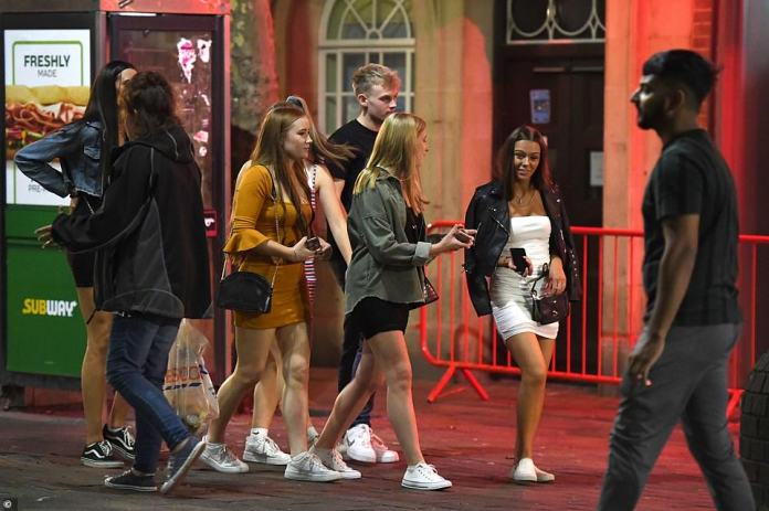 Revellers walk in a group as the enjoy their Tuesday night out in Portsmouth despite the Rule of Six measures now in place